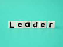 Leader word written on blue background Stock Image