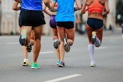 Leaders group of runners. Men and women running city marathon Royalty Free Stock Photo