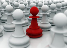 Leadership. Red pawn amongst many white paws Stock Photos