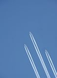 Leadership. Three planes fly forward leaving a trace Royalty Free Stock Images