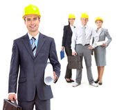 Leadership. Collage of confident architects in helmets with their leader in front royalty free stock photos