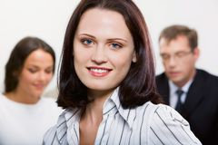 Leadership. Female leader on the background of  her business team Royalty Free Stock Photography