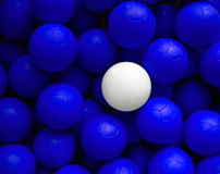Leadership. One white ball among lots of blue balls Royalty Free Stock Photography