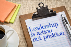 Leadership is action, not position. Reminder on a clipboard with a cup of coffee Stock Images