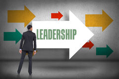 Leadership against arrows pointing Royalty Free Stock Image