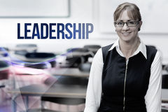 Leadership against smiling female teacher in the class room Royalty Free Stock Photo
