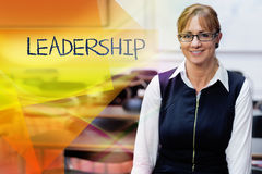 Leadership against smiling female teacher in the class room Stock Photos