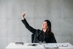 Leadership ambitious self affected business woman. Leadership and success. Ambitious, self affected business woman taking selfie at her office desk, smiling royalty free stock photos