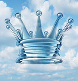 Leadership Aspirations. Business concept and metaphor with a royal king crown floating in the sky as a success symbol of religion and faith in a leader of ideas Royalty Free Stock Photography