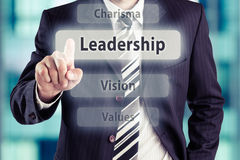Leadership. Businessman pressing leadership button at his office. Leadership concept, toned photo stock photos