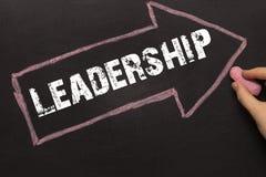 Leadership - Chalkboard with arrow on black Stock Photography