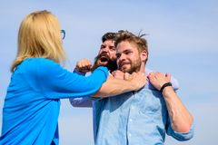 Leadership and competition concept. Man aggressive attacks lover his girlfriend. Men fighting for heart of lady. Woman. Tries stop violence, men fighting stock photos
