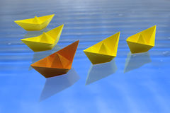 Leadership Concept. The orange ship is in the leadership in relation to the yellow ships. That is a leadership concept for a lot of things in the life Stock Images