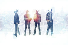 Leadership concept. Back view of businessmen silhouettes on abstract city background. Leadership concept. Double exposure Stock Photography