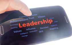 Leadership. Concept background ,hand holding a smart phone royalty free stock photos