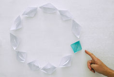 leadership concept, blue paper boat leading followers over white background Stock Image
