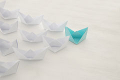 Leadership concept, blue paper boat leading followers Stock Images