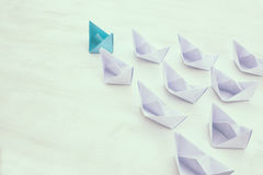 Leadership concept, blue paper boat leading followers Royalty Free Stock Images
