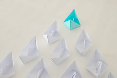 Leadership concept, blue paper boat leading followers Stock Image