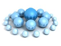 Leadership concept with blue spheres big and small Stock Photography