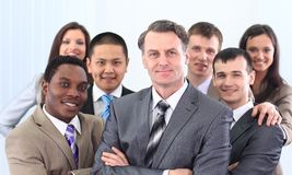Businessman and cohesive business team Royalty Free Stock Photography