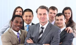 Businessman and cohesive business team Royalty Free Stock Photo