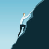 Leadership concept. A businessman is climbing on a top of the mo Stock Photo