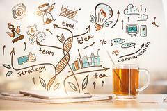Leadership concept. Close up of workplace with tea cup, paperwork and creative colorful business sketch. Leadership concept Royalty Free Stock Image