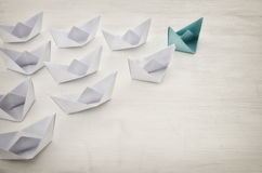 Leadership concept, green paper boat leading followers Royalty Free Stock Image