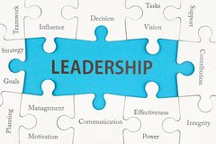 Leadership concept. With group of jigsaw puzzle pieces royalty free stock photography