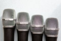 Leadership concept. group of microphones with golden one. freedom to speak up concept.  royalty free stock images