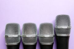 Leadership concept. group of microphones with golden one. freedom to speak up concept.  royalty free stock photo