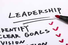 Leadership concept. Handwritting on paper Stock Images