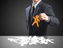 Leadership concept. Human resources officer choose employee standing out of the crowd. Leadership concept Stock Photo
