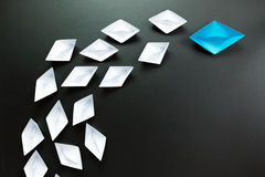 Leadership concept illustrated with paper ships Stock Images