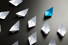 Leadership concept illustrated with paper ships Royalty Free Stock Images