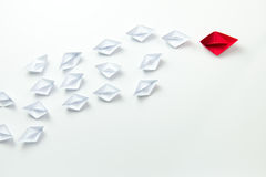 Leadership concept illustrated with paper ships Royalty Free Stock Photo