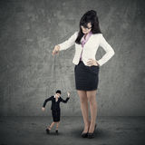 Leadership concept. Image of young businesswoman puppeteer. Leadership concept Stock Photography