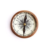 Leadership concept, isolated with clipping path. Brass compass with arrow pointing to LEADERSHIP sign, isolated with clipping path royalty free stock photo