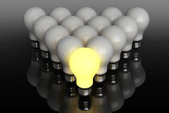 Leadership concept. One glowing light bulb standing in front of Stock Photo