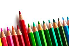 Leadership concept with one pencil standing out of crowd of othe. R pencils Royalty Free Stock Photo
