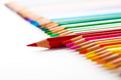 Leadership concept with one pencil standing out of crowd of othe. R pencils Royalty Free Stock Image