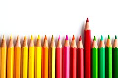 Leadership concept with one pencil standing out of crowd of othe. R pencils Stock Images