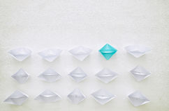 Leadership concept, paper boat leading followers Stock Image