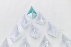 leadership concept, paper boat leading followers Stock Photo