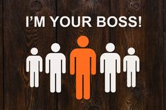 Leadership concept. Paper men on wooden background. Abstract conceptual image Royalty Free Stock Image