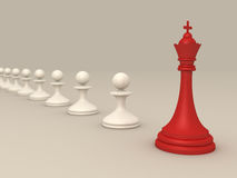 Leadership concept with Red chess king and pawns Royalty Free Stock Photos