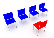 Leadership concept.  Red and four blue chairs Stock Photos