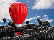 Leadership concept with red hot air balloon. Leadership concept with 3d rendering red hot air balloon flying above Stock Photo