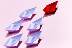 Leadership concept. Red paper ship leading among white Stock Image